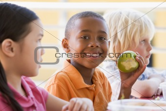 Kindergarten children eating lunch