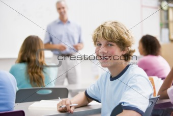 A schoolboy in a high school class