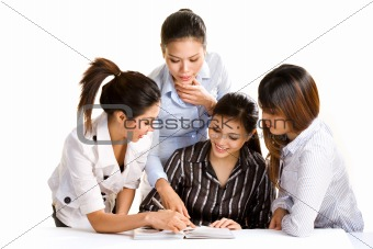 group of asian business women discussing work