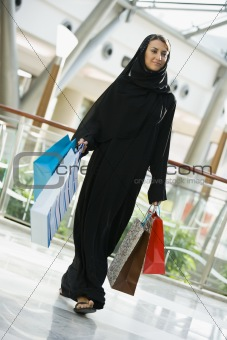 A Middle Eastern woman in a shopping mall