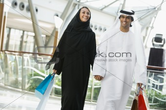 A Middle Eastern couple in a shopping mall