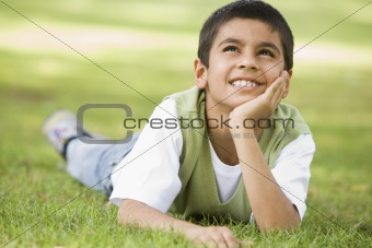 Boy relaxing in park