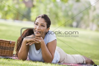 Woman relaxing in park with picnic