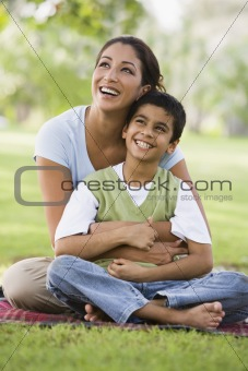 Mother and son relaxing in park