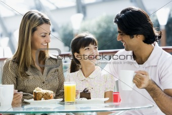 Family enjoying snack at cafe