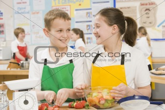 Schoolchildren at school in a cooking class