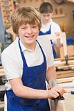 Schoolboy in woodwork class