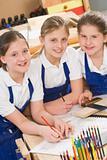 Schoolgirls in woodwork class