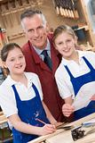 Schoolgirls and teacher in woodwork class