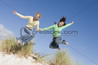 Two young women having fun at beach
