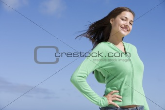 Portrait of young woman against blue sky