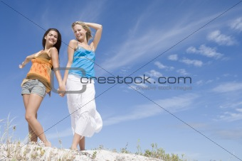 Two young women relaxing at beach