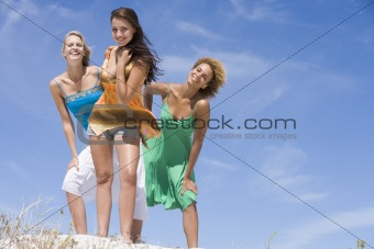 Three female friends relaxing at beach