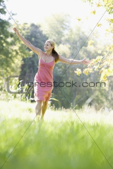 Young woman walking through countryside