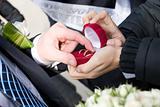 groom takes off wedding rings