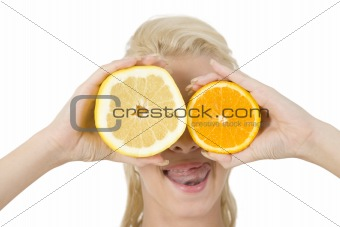 pretty lady covering her eyes with slice of fruits