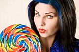 Pretty woman with a lollipop