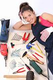 woman carpenter with work tools