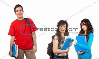 Three students with books and backpacks