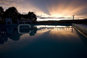 reflection of sunset over swimming pool