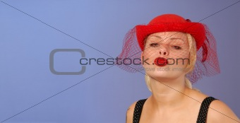 blond pin-up in hat blowing a kiss - space for text