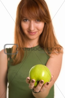 Fitness girl with green apple, focus on fruit