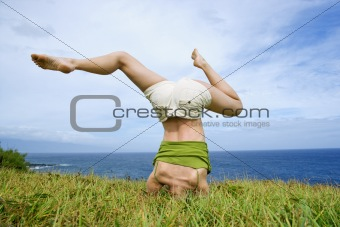 Woman doing headstand.