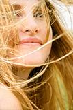 Woman's face in wind.