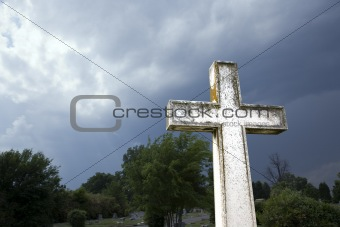 Cross against stormy sky.