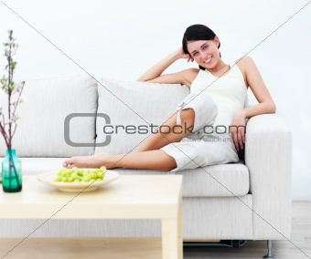 Smiling modern Happy young woman sitting on sofa