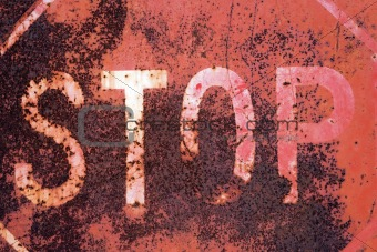 Old rusty stop sign
