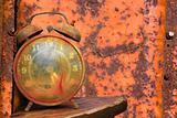 Alarm clock against orange.