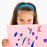 Hispanic girl holding drawing.