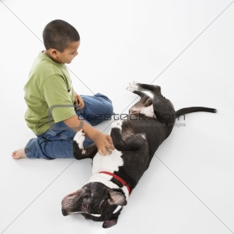 Boy petting pet dog