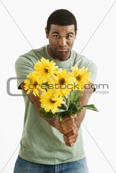 Pouting man with bouquet.