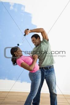 Painting couple playing around.