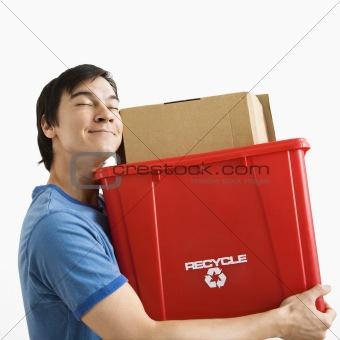 Man holding recycling bin.