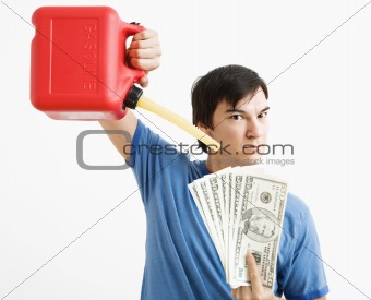 Man pouring gas on money.
