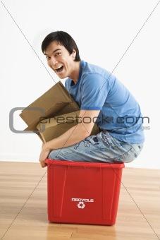 Man in recycling bin.