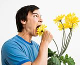 Man eating bouquet.