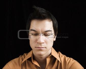 Portrait of man meditating.