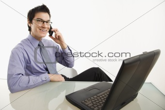 Smiling businessman on cell phone.