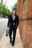 Businessman walking in city.