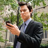 Businessman looking at cell phone.