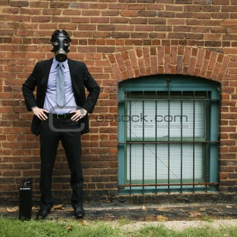 Businessman wearing gas mask.