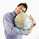 Man hugging globe