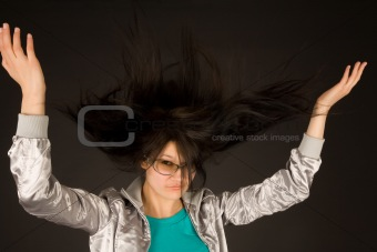 Beautiful girl shaking her hair