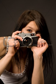 Beautiful photographer, focus on camera