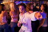 Young man in nightclub showing off for the camera