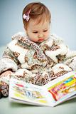 Small cute  reading a book